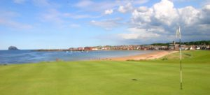 The course looks out over pristine beaches and a nearby hamlet at North Berwick - West Links, Scotland, United Kingdom