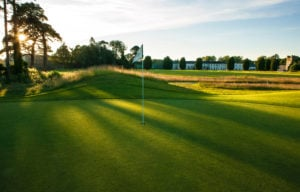 Observing a sunrise over a green at Castlemartyr Resort, Cork, Ireland