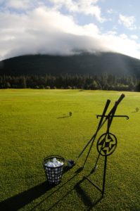 Image depicting the driving range and Mt Jefferson covered in cloud, Black Butte Ranch, Oregon, USA