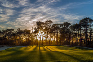 Image of the 15th hole at sunset, Pebble Beach, USA