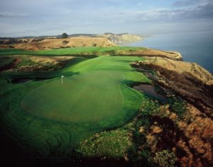 View of the 13th hole and background cliffs at Cape Kidnappers, Hawke's Bay, New Zealand