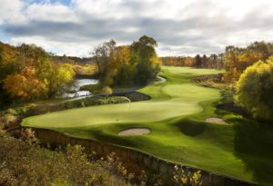 Image looking down at the 14th hole green and autumn trees, Destination Kohler, Wisconsin, USA