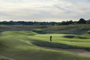 Image of a golfer playing the Meadow Valleys 4th hole, Destination Kohler, Wisconsin, USA