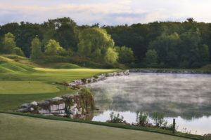 Image of mist rising from a lake next to the River Course 4th tee at Destination Kohler, Wisconsin, USA