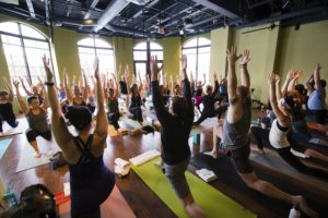Image of a Yoga Class on The Lake, located at the shops at Woodend, Destination Kohler, Wisconsin, USA